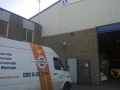 London removal van in front of a Warehouse