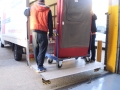 2 Removalists load a sofa with the tail-lift